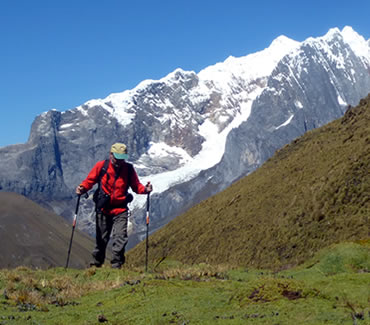 Tourist walking in the Cordillera Huayhuash